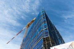 Construction site crane perspective. Apartment construction site and working crane. Copyspace Stock Image