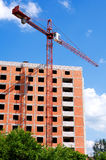 Construction site. With crane on blue sky stock images