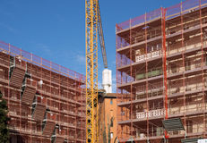 Construction site. With crane and blue sky Royalty Free Stock Photo