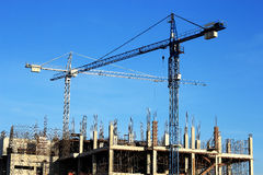 Construction site with crane. On  blue sky background Royalty Free Stock Images
