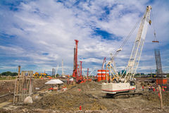 Construction site with crane and blue sky Royalty Free Stock Image