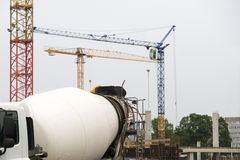 Construction site with crane and concrete mixer Royalty Free Stock Photography