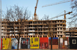 Construction site. With crane and graffitti on the fence royalty free stock photo