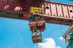 Construction site crane is lifting a concrete Stock Photo