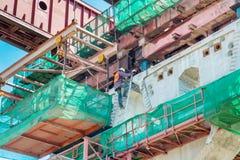 Construction site crane is lifting a concrete Stock Photos