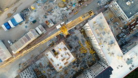Construction site, crane and lots of equipment. Aerial view stock footage