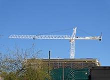 Construction site and crane. Men at construction site and crane Stock Photos