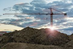 Construction site with a crane at sunset royalty free stock images