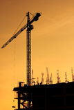 Construction site with crane. On  sunset background Stock Photo