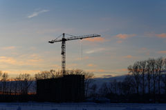 Construction site with crane at sunset. Stock Photography