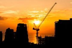 Construction site crane with sunset Stock Photos