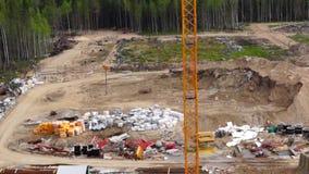 Construction site and crane tilt up stock video