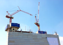Construction site with crane. Construction site with crane on the top of building Stock Images
