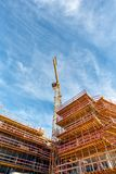 Construction Site with Crane under a Blue Cloudy Sky royalty free stock photo