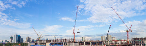 Construction site with crane worker and building as panorama Royalty Free Stock Photo
