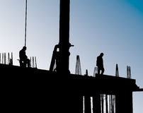 Construction site with crane and workers Royalty Free Stock Photos