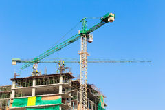 Construction site with crane and workers Stock Image