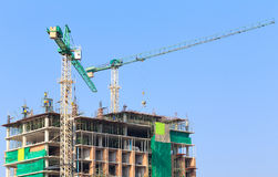 Construction site with crane and workers Stock Photo