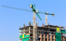 Construction site with crane and workers Royalty Free Stock Image