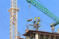 Construction site with crane and workers Stock Photos