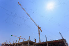 Construction site with crane and workers Royalty Free Stock Images