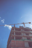 Construction site with crane working on vintage color tone Royalty Free Stock Photo
