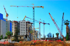 Construction Site Cranes. An urban construction site with many cranes Royalty Free Stock Photos