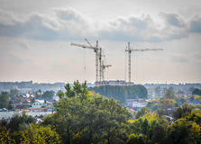 Construction site cranes afar Royalty Free Stock Images