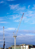 Construction site with cranes against blue sky Royalty Free Stock Images