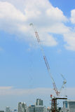 Construction site with cranes against blue sky, Building Construction. Royalty Free Stock Photography