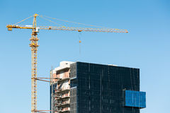 Construction site with cranes against blue sky Stock Image