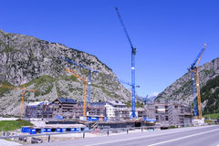 Construction site with cranes at Andermatt on the Swiss alps Stock Images