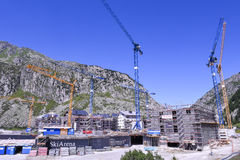 Construction site with cranes at Andermatt on the Swiss alps Royalty Free Stock Photo