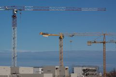 Construction site with cranes. On blue sky Royalty Free Stock Photos