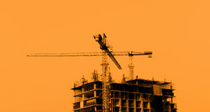 Construction site with cranes on blue sky background Royalty Free Stock Image