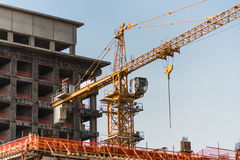 Construction site with cranes and building Stock Image