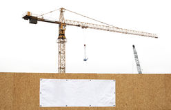 Construction site with cranes. Minimalistic construction site with cranes on white background and wall with copy space banner stock photos