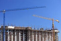 Construction site with cranes over a building stock photo