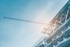 Construction site, cranes and scaffolding , concrete structure royalty free stock images