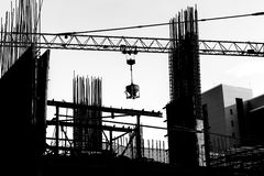 Construction site with cranes on silhouette background Royalty Free Stock Images