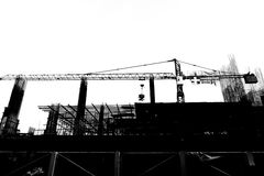 Construction site with cranes on silhouette background Royalty Free Stock Photography