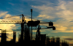 Construction site with cranes on silhouette background Stock Images