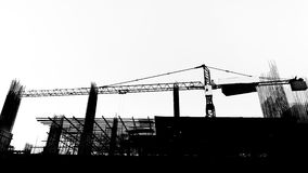 Construction site with cranes on silhouette background Stock Photography