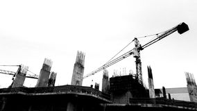 Construction site with cranes on silhouette background Royalty Free Stock Photo
