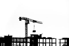 Construction site with cranes on silhouette background Royalty Free Stock Image