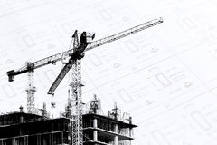 Construction site with cranes on silhouette with drawing backgro Royalty Free Stock Images
