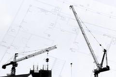 Construction site with cranes on silhouette with drawing backgro Stock Images