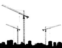 Construction site with cranes and silhouettes buildings Royalty Free Stock Photo