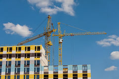 Construction site with cranes. On sky background Royalty Free Stock Photos
