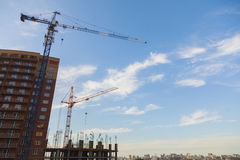 Construction site with cranes on sky background Royalty Free Stock Photo